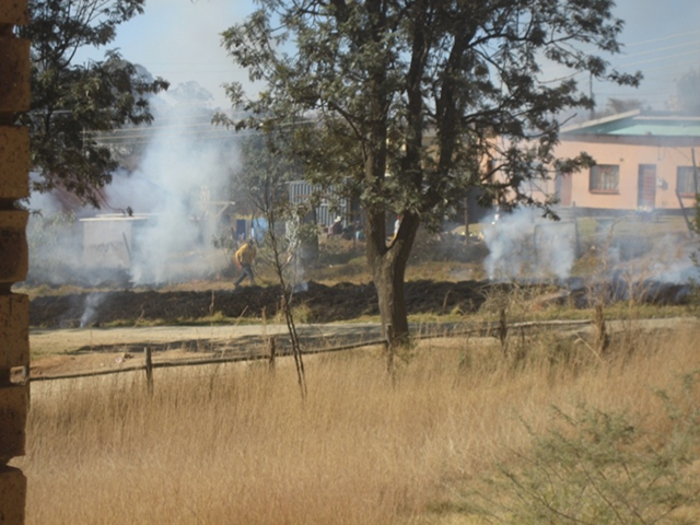 Burning the grass outside Kings Tavern